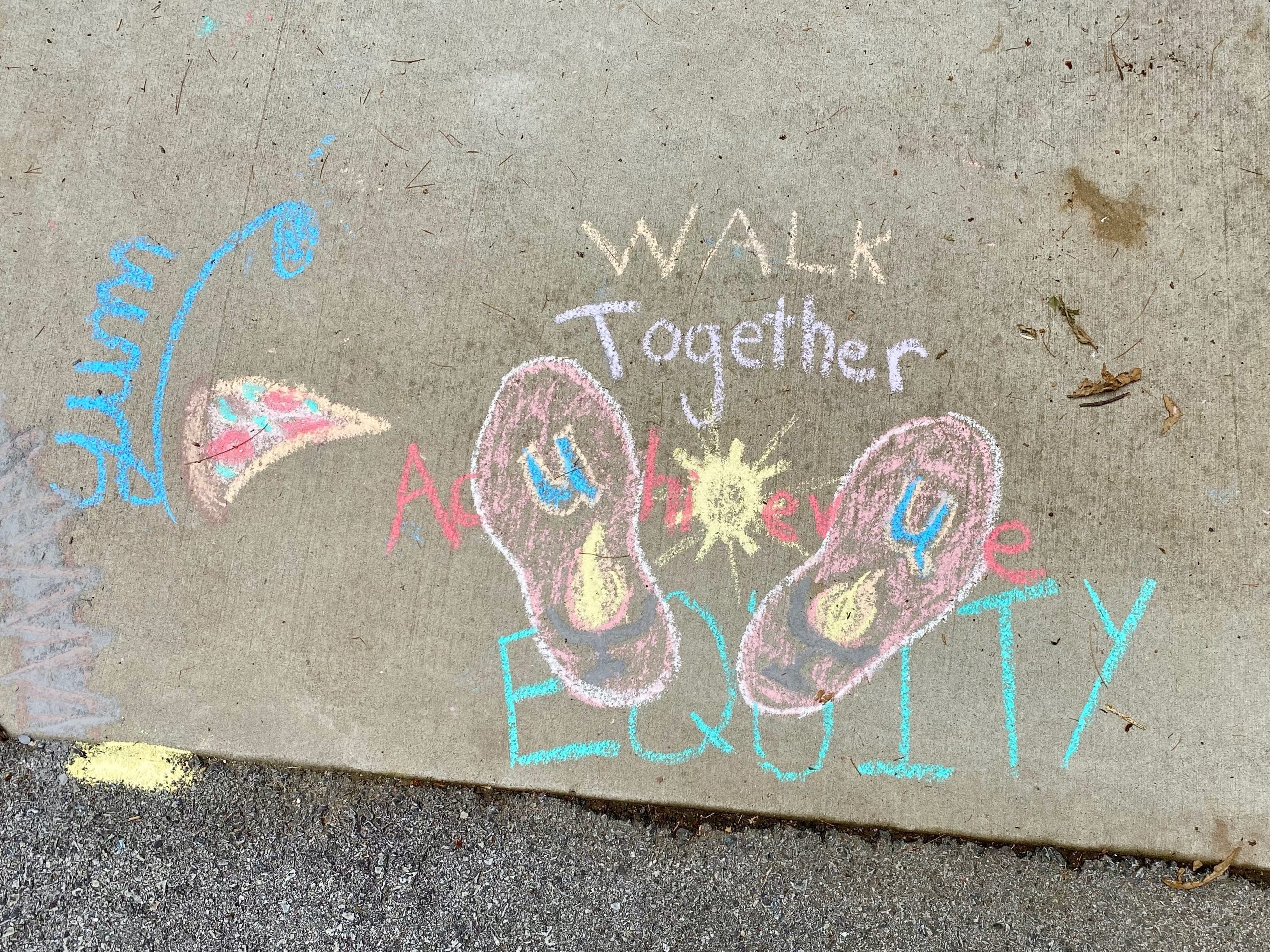 """Image of pizza slice """"Yum"""" and footprints with the words """"Walk Together Achieve Equity"""""""