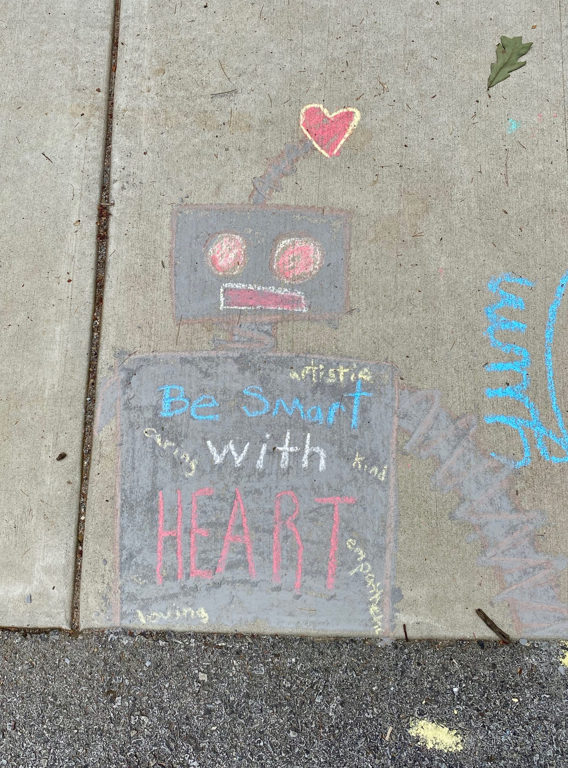 """Image of robot with the words """"Be Smart With Heart"""""""
